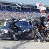 Photo - Crew members perform a pit stop on driver Kyle Busch's car during the NASCAR Nationwide series History 300 auto race at Charlotte Motor Speedway in Concord, N.C., Saturday, May 24, 2014. (AP Photo/Terry Renna)