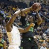 Photo - Baylor's Royce O'Neale, right, looks to shoot as West Virginia's Devin Williams defends during the first half of an NCAA college basketball game Saturday, Feb. 22, 2014, in Morgantown, W.Va. (AP Photo/Andrew Ferguson)