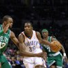 Photo - OKLAHOMA CITY THUNDER / BOSTON CELTICS/ NBA BASKETBALL  Oklahoma City Thunder forward Kevin Durant drives past Boston Celtic and Midwest City native Shelden Williams  with Marquis Daniels (7) in the background during the Thunder - Celtics game December 4, 2009 in the Ford Center in Oklahoma City.    BY HUGH SCOTT, THE OKLAHOMAN ORG XMIT: KOD