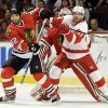 Detroit Red Wings\' Daniel Cleary, right, and Chicago Blackhawks\' Michal Rozsival battle as they wait for the puck during the first period of Game 1 of an NHL hockey playoffs Western Conference semifinal in Chicago, Wednesday, May 15, 2013. (AP Photo/Nam Y. Huh)
