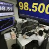 Photo - Money traders work under a screen indicating the U.S. dollar is trading at 98.500 yen at a foreign exchange company,  in Tokyo, Monday, April 8, 2013.  (AP Photo/Itsuo Inouye)