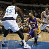 Dallas Mavericks\' Vince Carter, left, DeJuan Blair (45) and Jose Calderon, right, combine to strip the ball away fro Los Angeles Lakers\' Kendall Marshall (12) in the first half of an NBA basketball game, Tuesday, Jan. 7, 2014, in Dallas. (AP Photo/Tony Gutierrez)