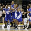 Kentrell Brothers, left, Donte Foster, Devon Hall, and Clayton Smith of Guthrie celebrate in front of Steven Hamilton of Tulsa Edison after Guthrie\'s win in the class 5A boys state basketball semifinal at the Ford Center in Oklahoma City, Friday March 7, 2008. BY BRYAN TERRY, THE OKLAHOMAN