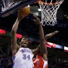Oklahoma City\'s Hasheem Thabeet (34) is fouled by the Clippers Lamar Odom (7) during an NBA basketball game between the Oklahoma City Thunder and the Los Angeles Clippers at Chesapeake Energy Arena in Oklahoma City, Wednesday, Nov. 21, 2012. Photo by Bryan Terry, The Oklahoman