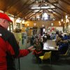 A wealthy philanthropist from Kansas City, Mo., known as Secret Santa, distributes $100 dollar bills to needy people at St. Joseph\'s Social Service Center in Elizabeth, N.J., Thursday, Nov. 29, 2012. (AP Photo/Rich Schultz)