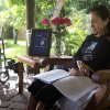 In this Dec. 31, 2012 photo, Susan Spencer-Wendel sits in her backyard at her home in West Palm Beach, Fla., reading a printed copy of her book. All the time-stamped rigors of daily journalism are behind her, but the pace of Spencer-Wendel\'s life has only been hastened. She is dying from Lou Gehrig\'s disease. What was once a constant rush to be first with her courthouse scoops has become a dash to live her remaining days joyfully, complete a long goodbye to those she loves, and record it all in a book that has drummed huge interest and a multimillion-dollar book deal. (AP Photo/J Pat Carter)