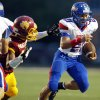Moore\'s Ryan Lujan (21) escapes from a Putnam City North defender during a high school football game between Putnam City North and Moore at Putnam City Stadium in Oklahoma City, Thursday, Sept. 27, 2012. Photo by Nate Billings, The Oklahoman