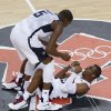 United States\' Kevin Durant and Chris Paul celebrate during the men\'s gold medal basketball game against Spain at the 2012 Summer Olympics, Sunday, Aug. 12, 2012, in London. The United States defeated Spain 107-100 to win the gold medal. (AP Photo/Victor Caivano)
