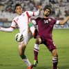 Photo - FILE - In this  June 4, 2013, file photo, Qatar's Ibrahim Al-Ghanim , right, battles against Iran's Reza Ghoochannejhad during their 2014 World Cup Asian zone qualifying soccer match at the Al-Sadd stadium in Doha. (AP Photo/Osama Faisal,File)