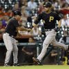 Photo -   Pittsburgh Pirates' Garrett Jones, right, is congratulated by third base coach Nick Leyva, left, after hitting a home run during the eighth inning of a baseball game against the Houston Astros, Friday, Sept. 21, 2012, in Houston. (AP Photo/David J. Phillip)