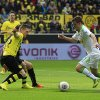 Photo - Moenchengladbach's Max Kruse, right, is on his way to score during the German first division Bundesliga soccer match between BvB Borussia Dortmund and VfL Borussia Moenchengladbach in Dortmund, Germany, Saturday, March 15, 2014. (AP Photo/Frank Augstein)