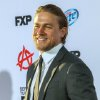 Photo - Actor Charlie Hunnam arrives at the season 6 premiere screening of