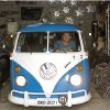 In this Sept. 16, 2013 photo, Enio Guarnieri poses for a photo in his 1972 Volkswagen van, in his garage in Sao Paulo, Brazil. Guarnieri bought the vehicle a year ago to stoke childhood memories. When he was 10, his father taught him to drive a Kombi.