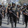 Bangladeshi security personnel patrol in front of Baitul Mukarram mosque in Dhaka, Bangladesh, Friday, March 1, 2013. Protesters clashed with police for a second day Friday as the death toll rose to at least 44 in clashes triggered by a death sentence given to Delwar Hossain Sayedee, one of the top leaders of the country\'s largest Islamic party Jamaat-e-Islami, for crimes linked to Bangladesh\'s 1971 independence war, police said. (AP Photo/A.M. Ahad)