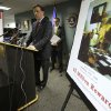 Anthony Amore, chief of security at the Gardner Museum, center, stands next to a poster that shows an image of a Vermeer painting and lists a reward, right, while facing reporters during a news conference at FBI headquarters in Boston, Monday, March 18, 2013. The FBI believes it knows the identities of the thieves who stole art valued at up to $500 million from Boston\'s Isabella Stewart Gardner Museum more than two decades ago. (AP Photo/Steven Senne)