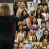 Over 700 fourth and fifth grade students from the Mid-Del school district, conducted by Suzanne Morrison, perform during the 57th Annual Elementary Vocal Music Festival at the Carl Albert High School Fieldhouse in Midwest City, Okla. on Thursday, April 30, 2009. BY BRENDA O\'BRIAN, THE OKLAHOMAN