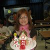 Chisholm Elementary third-grader Ali Boone proudly displays her freshly built gingerbread house. - PHOTO BY LILLIE-BETH BRINKMAN, THE OKLAHOMAN ORG XMIT: 0812191611289946 ORG XMIT: RDA9VFV
