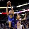 Golden State Warriors\' Klay Thompson (11) drives past Phoenix Suns\' Goran Dragic, of Slovenia, during the first half of an NBA basketball game on Friday, April 5, 2013, in Phoenix. (AP Photo/Matt York)