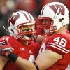 Wisconsin\'s Jared Abbrederis, left, and Jacob Pedersen celebrate Abbrederis\' touchdown during the second half of an NCAA college football game against Illinois, Saturday, Oct. 6, 2012, in Madison, Wis. Wisconsin won 31-14. (AP Photo/Andy Manis)