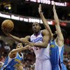 Philadelphia 76ers\' Thaddeus Young, center, drives to the basket between New Orleans Hornets\' Greivis Vasquez, right, of Venezuela, and Anthony Davis (23) during the first half of an NBA basketball game, Tuesday, Jan. 15, 2013, in Philadelphia. (AP Photo/Matt Slocum)