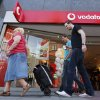 People walk past a Vodafone shop in London, on Friday, June 6, 2014. Vodafone, one of the world\'s largest cellphone companies, revealed the scope of government snooping into phone networks Friday, saying authorities in some countries are able to directly access an operator\'s network without seeking permission. The company outlined the details in a report that is described as the first of its kind, covering 29 countries in which it directly operates. It gives the most comprehensive look to date on how governments monitor the communications of their citizens. (AP Photo/Lefteris Pitarakis)