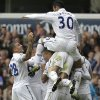 Tottenham Hotspur\'s players celebrate their goal against Aston Villa during a Premier League soccer match at White Hart Lane ground in London, Sunday, Oct. 7, 2012. Tottenham Hotspur won the match 2-0. (AP Photo/Lefteris Pitarakis)