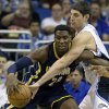 Indiana Pacers\' Ian Mahinmi, left, of France, drives against Orlando Magic\'s Nikola Vucevic, of Montenegro,during the first half of an NBA basketball game, Wednesday, Jan. 16, 2013, in Orlando, Fla. (AP Photo/John Raoux)