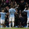 Photo - Manchester City's Sergio Aguero, left, celebrates with teammates after scoring the third of his 3 goals past Watford's goalkeeper Jonathan Bond during their English FA Cup fourth round soccer match at The City of Manchester Stadium, Manchester, England, Saturday, Jan. 25, 2014. (AP Photo/Jon Super)