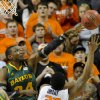 Photo - Baylor forward Cory Jefferson, left, deflects a shot over Oklahoma State guard Marcus Smart during the first half of an NCAA college basketball game in Stillwater, Okla., Wednesday, Feb. 6, 2013. (AP Photo/Brody Schmidt)