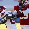 Oklahoma\'s Ryan Broyles (85) stiff arms Stanford\'s Austin Yancy (23) during the second half of the Brut Sun Bowl college football game between the University of Oklahoma Sooners (OU) and the Stanford University Cardinal on Thursday, Dec. 31, 2009, in El Paso, Tex. Photo by Chris Landsberger, The Oklahoman