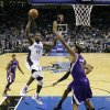Orlando Magic\'s Andrew Nicholson (44) drives to the basket againstr Sacramento Kings\' DeMarcus Cousins (15) during the first half of an NBA basketball game, Wednesday, Feb. 27, 2013, in Orlando, Fla. (AP Photo/John Raoux)