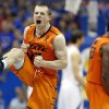 Oklahoma State\'s Phil Forte celebrates defeating Kansas in an NCAA college basketball game in Lawrence, Kan. on Saturday, Feb. 2, 2013. (AP Photo/The Wichita Eagle, Travis Heying) ORG XMIT: KSWIE101