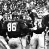 COLLEGE FOOTBALL / UNIVERSITY OF OKLAHOMA: OU linebacker Brian Bosworth and other members of the OU defense celebrate after stopping the Stanford Cardinals for a 5-yard loss in the 4th quarter of the OU-Stanford game (a 19-7 home-opener win) on September 8, 1984. Staff photo by Jim Argo taken 9/8/84.