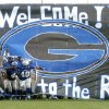 Guthrie football players, led by running back Kris King, run through a banner on their way onto the Jelsma Stadium field for their first game at the stadium in two years, prior to the Guthrie vs Shawnee high school football game at Jelsma Stadium in Guthrie, Okla., August 31, 2006. The Rock is the nickname for Jelsma Stadium. By Matt Strasen, The Oklahoman ORG XMIT: KOD