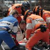 Photo - Emergency personnel pull Chase Austin from his damaged car after he hit the wall in the first turn during the Indy Lights Freedom 100 auto race at the Indianapolis Motor Speedway in Indianapolis, Friday, May 23, 2014. (AP Photo/Bill Friel)