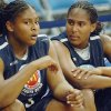 Courtney (L) and Ashley Paris (R) sit on the bench watching during a scrimmage which was a prelude to the 2005 McDonald\'s All American High School Basketball Game in South Bend, Indiana, March 29, 2005. HO-MCDONALD\'S/Henny Ray Abrams