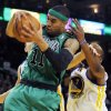Boston Celtics\' Courtney Lee, front, rebounds in front of Golden State Warriors\' Andris Biedrins, behind left and Carl Landry, during the first half of an NBA basketball game in Oakland, Calif., Saturday, Dec. 29, 2012. (AP Photo/George Nikitin)