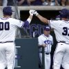Photo - TCU's Kevin Cron (00) is congratulated after scoring on teammate's Jerrick Suiter (31) sacrifice fly against Sam Houston State during the second inning of an NCAA college baseball regional tournament game, Sunday, June 1, 2014, in Fort Worth, Texas. (AP Photo/Jim Cowsert)