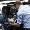 Photo - FILE - This is a Tuesday July 23, 2013 file photo of Britain's Prince William places carefully the Prince George of Cambridge into a car, Tuesday July 23, 2013, as they leave St. Mary's Hospital exclusive Lindo Wing in London where the Duchess gave birth on Monday July 22.  Britain's Prince William has described his joy at introducing newborn  son to the world on the steps of a London hospital last month  and about his nerves about fitting the car seat securely into the Land Rover before driving off.  (AP Photo/Sang Tan, File)