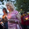 Photo - In this May 29, 2014 photo, Denee Mallon, center, joins a candlelight vigil organized by Albuquerque Pride in Albuquerque, N.M. A U.S. Department of Health and Services review board ruled Friday, May 30, in favor of Mallon, a 74-year-old Army veteran, whose request to have Medicare pay for her genital reconstruction was denied two years ago. The decision recognizes sex reassignment surgeries as a medically necessary and effective treatment for individuals who do not identify with their biological sex. (AP Photo/Craig Fritz)