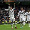 Real Madrid\'s Cristiano Ronaldo from Portugal, left, celebrates his goal with Mesut Ozil from Germany, center, during a Spanish La Liga soccer match against Getafe at the Santiago Bernabeu stadium in Madrid, Spain, Sunday, Jan. 27, 2013. (AP Photo/Andres Kudacki)