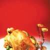 Photo - A roast turkey on a plate and wine glasses (clip art)