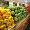 Photo - Bell peppers are neatly stacked at the Sunflower Farmers Market grocery store in Oklahoma City.  Photo By Paul Hellstern, The Oklahoman