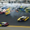 Trevor Bayne (21), Carl Edwards (99), David Gilliland (38), Terry Labonte (32), David Ragan (34) and Ricky Stenhouse Jr. (17) collide between Turn 1 and Turn 2 as Jeff Gordon (24) and Marcos Ambrose (9) drive by during the NASCAR Daytona 500 Sprint Cup Series auto race at Daytona International Speedway in Daytona Beach, Fla., Sunday, Feb. 24, 2013. (AP Photo/Phelan M. Ebenhack)