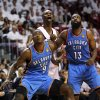 Miami Heat\'s Chris Bosh, center, fights for position under the basket against Oklahoma City Thunder\'s Serge Ibaka (9) and James Harden (13) during the third quarter of Game 3 in the NBA Finals basketball series, Sunday, June 17, 2012, in Miami. The Heat won 91-85. (AP Photo/El Nuevo Herald, David Santiago) MAGS OUT ORG XMIT: FLMEH308