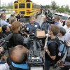 Hood County Commissioner Steve Berry, center, talks to the media before the bus tour of the ravaged residential area Rancho Brazos in Granbury, Texas, Thursday May 16, 2013. Ten tornadoes touched down in several small communities in North Texas overnight, leaving at least six people dead, dozens injured and hundreds homeless. (AP Photo/The Fort Worth Star-Telegram,Paul Moseley) MAGS OUT; (FORT WORTH WEEKLY, 360 WEST);