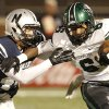 EN#4 Lance Dixon wraps up NN#6 Z\'quan Hogan during the high school football game between Norman North and Edmond North in Edmond at Wantland Stadium Friday, Friday, October 18, 2013. Photo by Doug Hoke, The Oklahoman