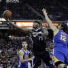 Sacramento Kings center DeMarcus Cousins, center, drives to the basket between Golden State Warriors\' Klay Thompson, left, and Andrew Bogut, of Australia, during the second half of an NBA basketball game in Sacramento, Calif., Monday, Nov. 5, 2012. The Kings won 94-92.(AP Photo/Rich Pedroncelli)