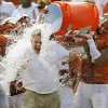 Texas head coach Mack Brown is doused with water by his players, including Jackson Jeffcoat (44) the Red River Rivalry college football game between the University of Oklahoma Sooners and the University of Texas Longhorns at the Cotton Bowl Stadium in Dallas, Saturday, Oct. 12, 2013. UT won, 36-20. Photo by Nate Billings, The Oklahoman