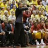 Photo - Iowa State head coach Fred Hoiberg directs his team during the first half of an NCAA college basketball game against Kansas, Monday, Jan. 13, 2014, in Ames, Iowa. (AP Photo/Charlie Neibergall)